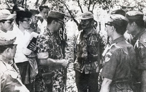 A dark history -- Maj. Gen. Soeharto briefs members of the Army's Special Forces (RPKAD, now Kopassus) prior to the removal of the bodies of the Army generals who were murdered during an alleged coup attempt on Sept. 30, 1965, which was blamed on the now defunct Indonesian Communist Party (PKI). As the most senior military officer available at the time, Soeharto led all the operations to restore security and impose order in the aftermath of the alleged attempt.