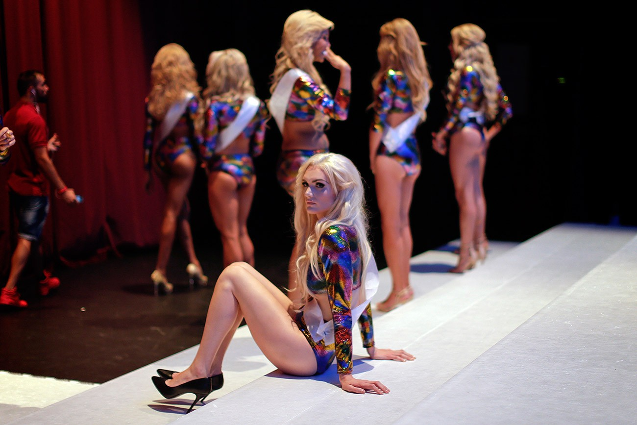 In this Sunday, Sept. 18, 2016 photo, participants wait on stage ahead of Miss Trans Star International 2016 show celebrated in Barcelona, Spain. Twenty-eight women representing as many countries competed last weekend to be crowned  Miss Trans Star International, Europe's largest beauty pageant for transgender women and one of a growing number of similar events aimed at celebrating a population more often condemned.
