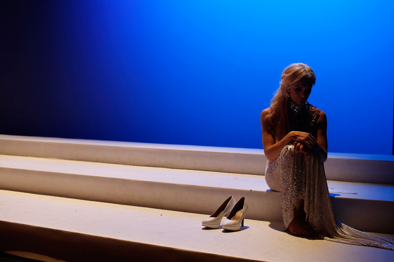 In this Sunday, Sept. 18, 2016 photo, Linni Rows Wiman, from Sweden, sits on the stage during an interval in the Miss Trans Star International 2016 show celebrated in Barcelona, Spain. Twenty-eight women representing as many countries competed last weekend to be crowned  Miss Trans Star International, Europe's largest beauty pageant for transgender women and one of a growing number of similar events aimed at celebrating a population more often condemned.
