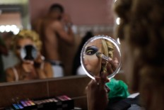 In this Sunday, Sept. 18, 2016 photo, Jey Jonnais, from Panama, applies make up ahead of the Miss Trans Star International 2016 show celebrated in Barcelona, Spain.