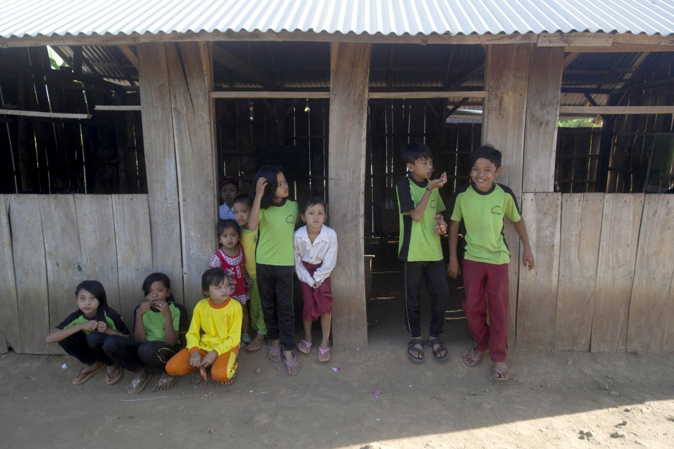 Students gather outside the two classrooms before school starts. JP/ Sigit Pamungkas