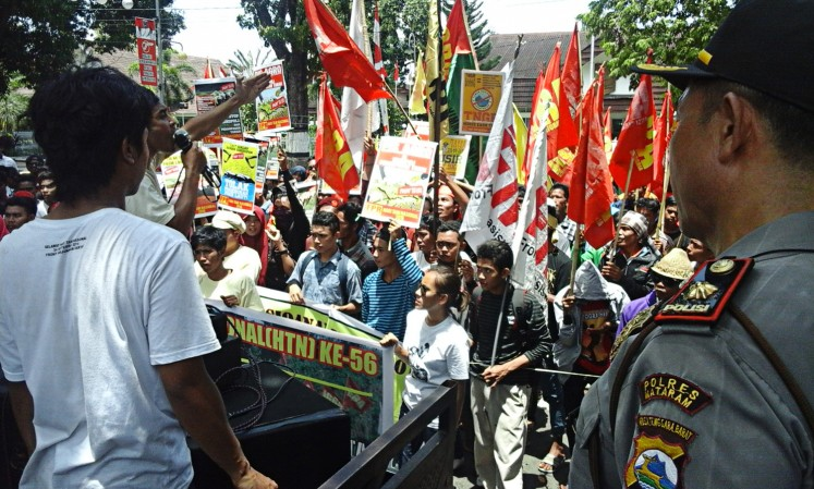 Activists, students and farmers call on the government to carry out land reforms in a rally in Mataram, West Nusa Tenggara.