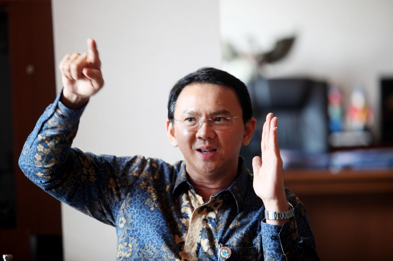 Ahok denies he insulted the Quran
