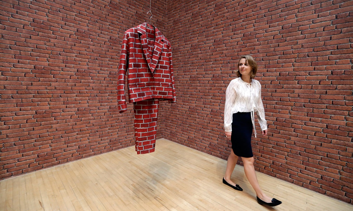 A woman looks towards part of an artwork called 'Lichen! Libido! [London!] Chastity!' by Anthea Hamilton, one of the four artists shortlisted for the Turner Prize 2016, as it is displayed at the Tate Britain gallery in London, Monday, Sept. 26, 2016. The Turner Prize aims to promote public debate around new developments in contemporary British art. AP Photo/Kirsty Wigglesworth