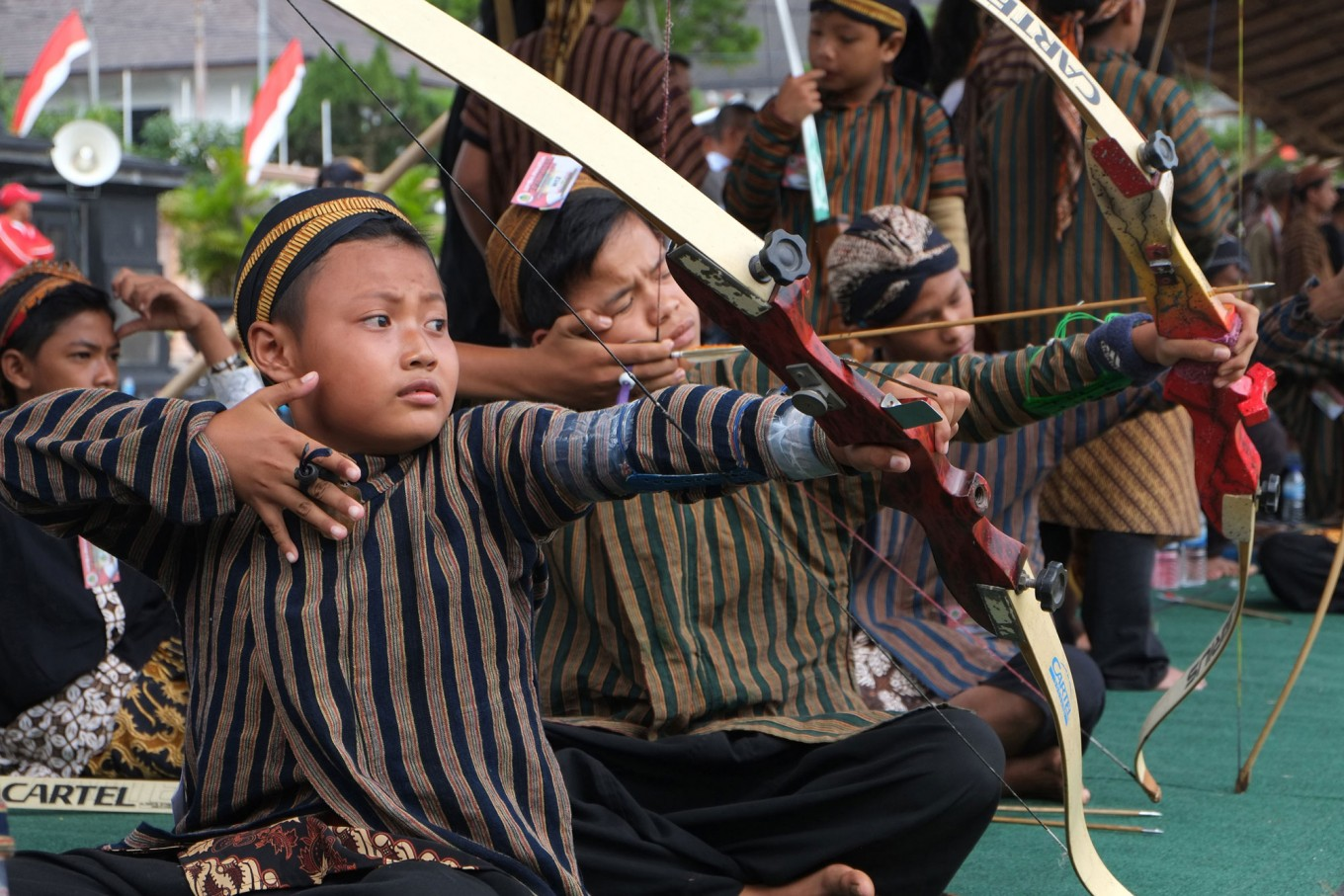 Youngsters continue the jemparingan tradition of their forefathers. JP/ Ganug Nugroho Adi