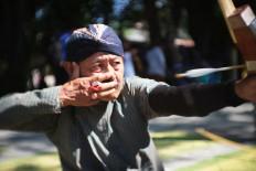 An archer releases his arrow. JP/ Ganug Nugroho Adi