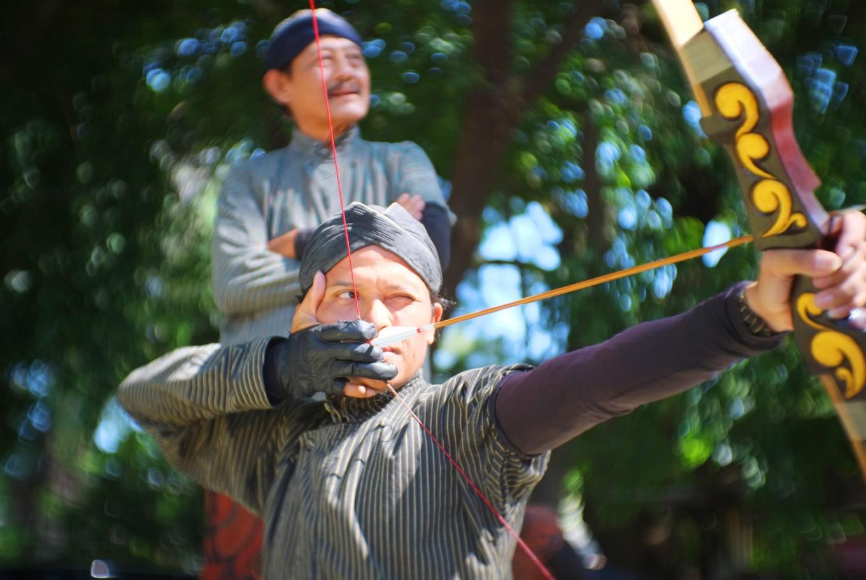 A participant aims for his target in Jemparingan at Taman Sriwedari in Surakarta, Central Java.  JP/ Ganug Nugroho Adi