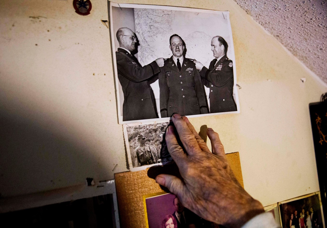 Memorabilia decorates a wall in the home of Frank Gleason, 96, a retired colonel with the Office of Strategic Services, in Atlanta, Wednesday, Sept. 28, 2016. Legislation to recognize the contributions of a group of World War II spies is hung up in Congress. Some 75 years ago, the OSS carried out missions behind enemy lines in Nazi Germany and the Pacific theatre. Gleason's group was tasked with halting the Japanese advance into China. Gleason and his comrades did this by detonating bridges, railroad tracks and anything else. 'We just blew stuff up left and right,' said Gleason. AP Photo/David Goldman