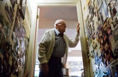 Frank Gleason, 96, a retired colonel with the Office of Strategic Services, looks over memorabilia decorating a wall in his home in Atlanta, Wednesday, Sept. 28, 2016. Legislation to recognize the contributions of a group of World War II spies is hung up in Congress. Some 75 years ago, the OSS carried out missions behind enemy lines in Nazi Germany and the Pacific theatre. Gleason's group was tasked with halting the Japanese advance into China. Gleason and his comrades did this by detonating bridges, railroad tracks and anything else. 'We just blew stuff up left and right,' said Gleason. AP Photo/David Goldman
