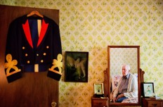 Frank Gleason, 96, a retired colonel with the Office of Strategic Services, looks at his old blue mess dress uniform hanging on a door as he sits in his home in Atlanta, Wednesday, Sept. 28, 2016. Legislation to recognize the contributions of a group of World War II spies is hung up in Congress. Some 75 years ago, the OSS carried out missions behind enemy lines in Nazi Germany and the Pacific theatre. The organization disbanded at the end of the war, but served as a forerunner to the CIA. AP Photo/David Goldman