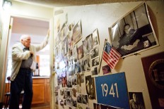 Memorabilia decorates a wall in the home of Frank Gleason, 96, rear, a retired colonel with the Office of Strategic Services, in Atlanta, Wednesday, Sept. 28, 2016. Legislation to recognize the contributions of a group of World War II spies is hung up in Congress. Some 75 years ago, the OSS carried out missions behind enemy lines in Nazi Germany and the Pacific theatre. Gleason's group was tasked with halting the Japanese advance into China. Gleason and his comrades did this by detonating bridges, railroad  tracks and anything else. 'We just blew stuff up left and right,' said Gleason. AP Photo/David Goldman