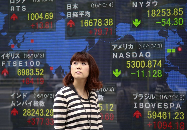 Asian markets mostly up on vaccine, stimulus optimism