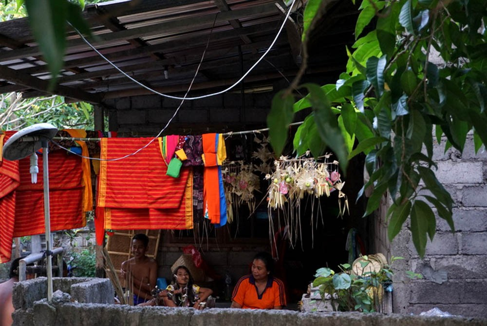 A view of a Karangasem resident's yard where parents are drying various fabrics and paraphernalia for daha [young unmarried women] and teruna [young unmarried men] who will follow the Usaba Dangsil procession for several weeks. The last ceremony was held 14 years ago at Bungaya, one of the oldest villages in Karangasem, Bali. JP/ Luh De Suriyani