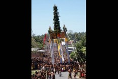 Tens of thousands of people participate in the majestic Usaba Dangsil ritual in Karangasem Bali, in late August. The seven giant pillars symbolize welfare and protection. JP/ Luh De Suriyani