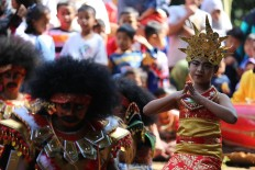 A girl performs a traditional dance. JP/Ganug Nugroho Adi
