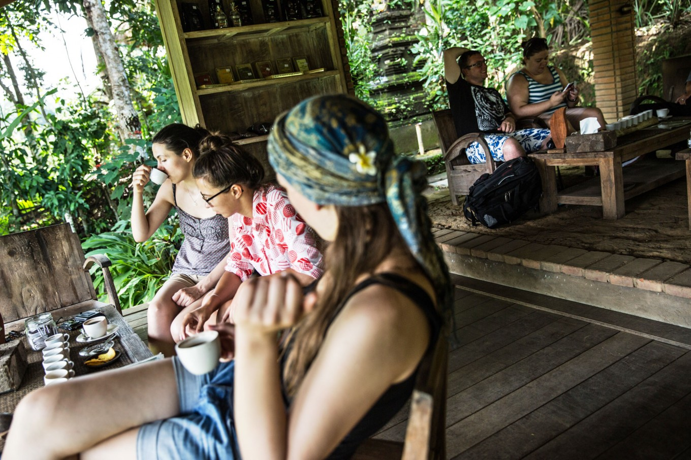 Tourists enjoy the beautiful scenery of coffee trees at the Bali Pulina agrotourism center in Tegalalang, Bali. JP/Agung Parameswara