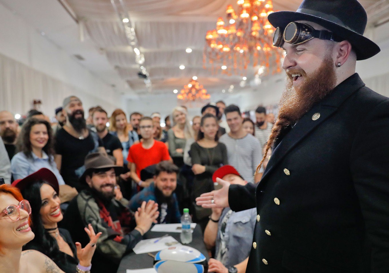 In this picture taken on Sunday, Oct. 16, 2016, a man smiles after having his beard evaluated by a jury during the National Competition for Beards and Mustaches which took place along with the International Tattoo Convention Bucharest 2016 in Bucharest, Romania. AP Photo/Vadim Ghirda