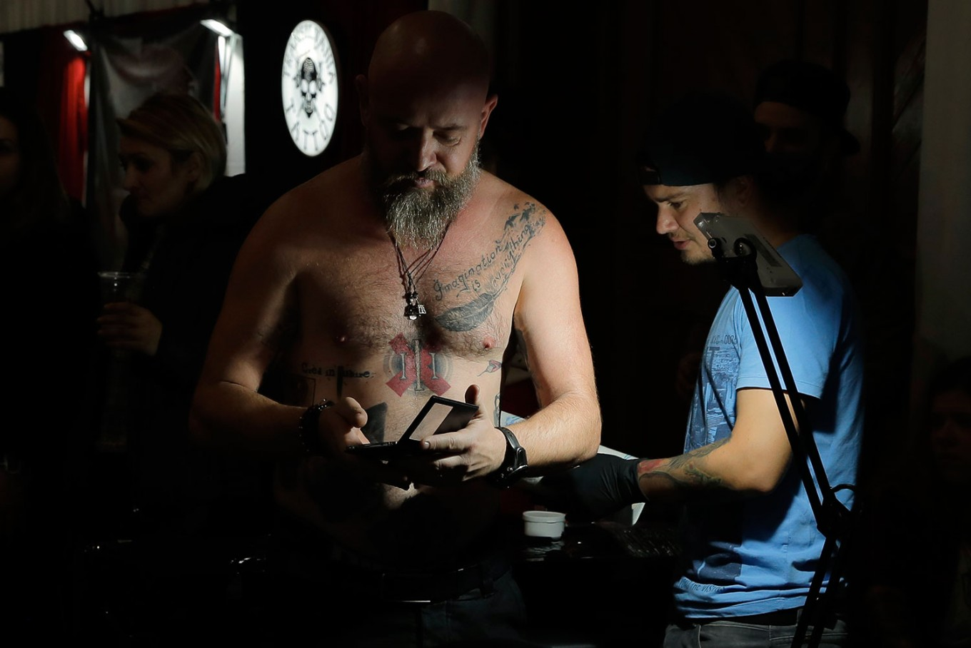 In this picture taken on Sunday, Oct. 16, 2016, a man gets a tattoo during the International Tattoo Convention Bucharest 2016 in Bucharest, Romania. AP Photo/Vadim Ghirda