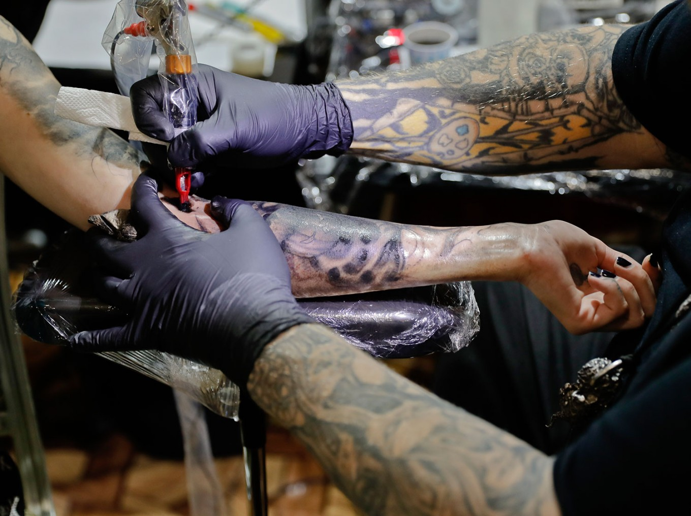 In this picture taken on Sunday, Oct. 16, 2016, Paul Booth of the U.S., one of the world's most famous tattoo artists, works during the International Tattoo Convention Bucharest 2016 in Bucharest, Romania. AP Photo/Vadim Ghirda