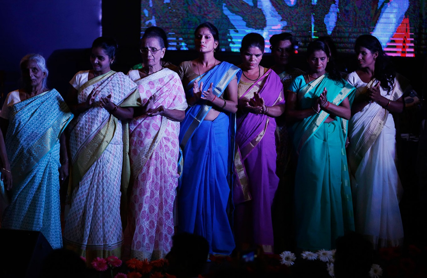 Indian Hindu widows applaud as they stand on stage during a fashion show in New Delhi, India, Saturday, Oct. 15, 2016. In most of India, millions of Hindu widows are expected to live out their days in quiet worship, dressed only in white. They are typically barred from all religious festivities because their very presence is considered inauspicious. They are now breaking age-old traditions of staying aloof by actively participating in Hindu festivals like Holi and Diwali. On Saturday, they went a step further recently, participating in a fashion show. AP Photo/Altaf Qadri