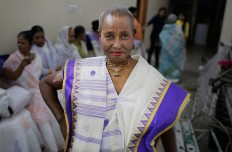 An Indian Hindu widow practices to walk on the runway before a fashion show in New Delhi, India, Saturday, Oct. 15, 2016. Until recently, Indian widows were expected to follow the sociocultural codes of a patriarchal Hindu society that demands a woman lead a life of asceticism after a husband's death. Their lives appear to be changing for better with women's groups and Indian aid organizations taking interest in their welfare. AP Photo/Altaf Qadri
