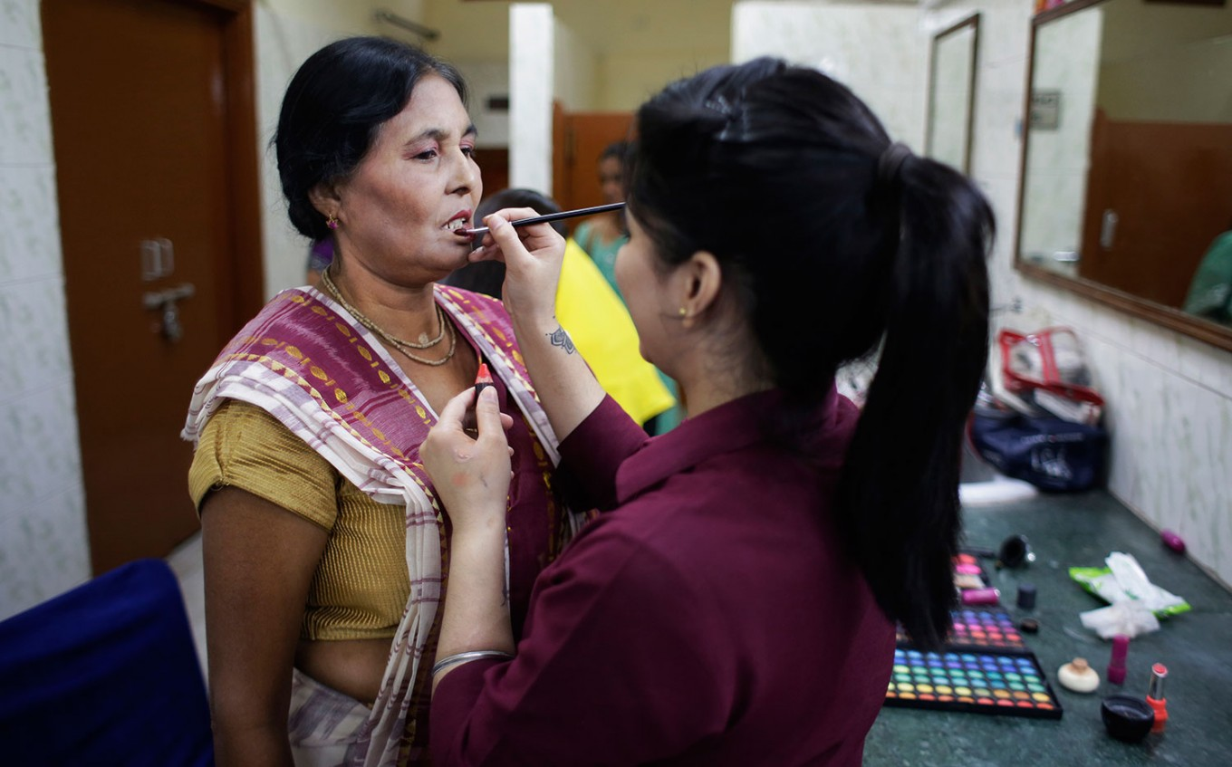 A makeup artist gets an Indian Hindu widow ready for a fashion show in New Delhi, India, Saturday, Oct. 15, 2016. Until recently, Indian widows were expected to follow the sociocultural codes of a patriarchal Hindu society that demands a woman lead a life of asceticism after a husband's death. Their lives appear to be changing for better with women's groups and Indian aid organizations taking interest in their welfare. AP Photo/Altaf Qadri