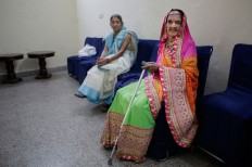 An elderly Indian Hindu widow waits for her turn to walk the ramp during a fashion show in New Delhi, India, Saturday, Oct. 15, 2016. In most of India, millions of Hindu widows are expected to live out their days in quiet worship, dressed only in white. The widows are now breaking age-old traditions of staying aloof by actively participating in Hindu festivals like Holi and Diwali. They went a step further on Saturday, participating in a fashion show. AP Photo/Altaf Qadri