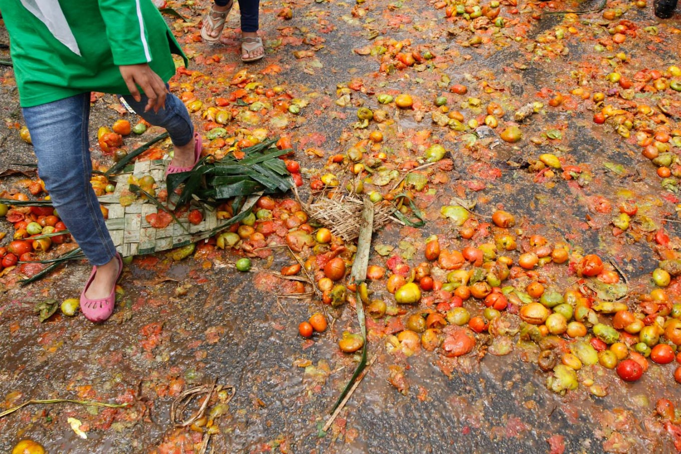 The streets of Cikareumbi Kampung were covered in tomatoes after the fight ended. JP/Arya Dipa