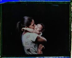 "In this Sept. 26, 2016 photo made from a negative recovered from instant film, Angelica Pereira kisses her daughter Luiza, who was born with microcephaly, one of many serious medical problems that can be caused by congenital Zika syndrome, during a portrait session in Santa Cruz do Capibaribe, Pernambuco state, Brazil. ""We are always chasing something. We have to drop everything else, all our chores, our homes,"" said the 21-year-old. ""There are so many of us with children with special needs. [The government] is forgetting about that."" AP Photo/Felipe Dana"