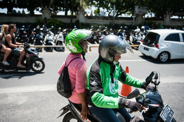 Yayuk takes motorcycle taxis and public transportation to get around. JP/ Anggara Mahendra
