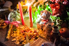 A canang, an offering by Balinese Hindus comprises beer and flowers at the Ground Zero monument on Oct. 12. JP/Anggara Mahendra