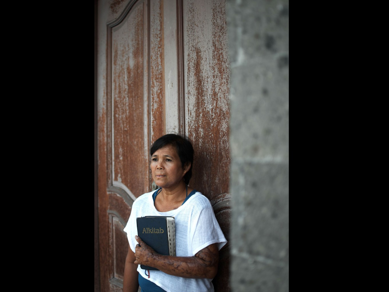 Yayuk on July 2, 2012 posing with a Bible. She converted to Christianity from Islam after the bombing. JP/ Anggara Mahendra
