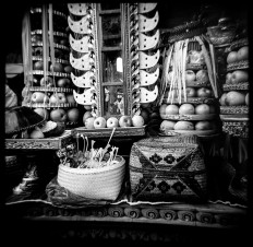 A boy, seen reflected in the mirror among a batch of offerings, walks to Panti Timrah Temple to attend the Dewa Masraman ritual. The ritual pays homage to ancestors through offerings and various activities centered around the gods throughout the day, before effigies of deities are installed in palanquins and carried around the temple. JP/ Agung Parameswara