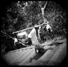 A man carries offerings as he walks to Guman Hill during the Ngusaba Gumang ritual at Bugbug village in Karangasem. JP/ Agung Parameswara