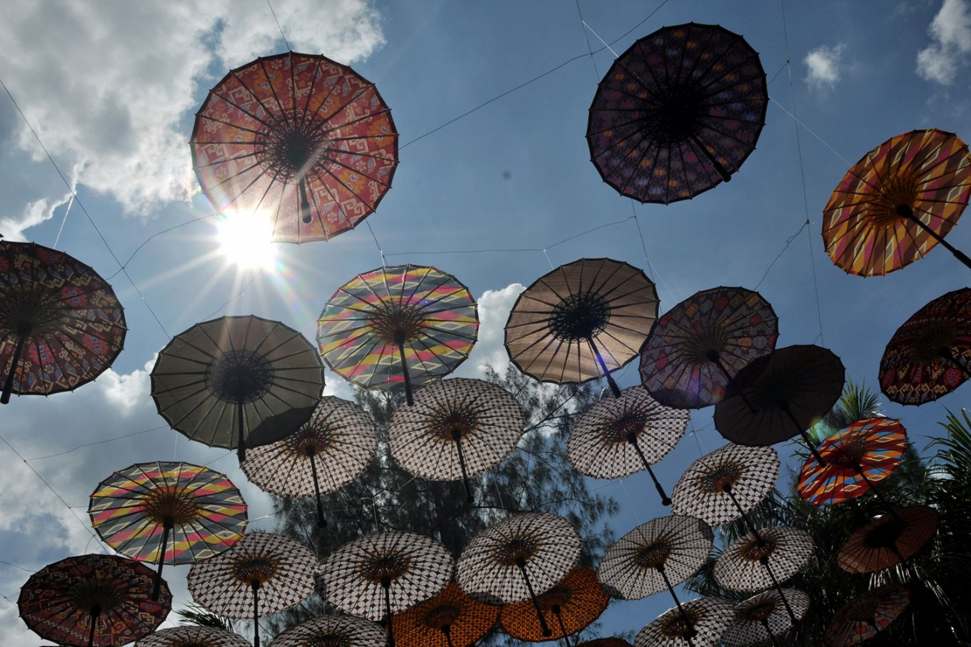 "A vivid scene of colorful umbrellas against the background of the blue sky perfectly translates the 2016 Indonesian Umbrella Festival's (FPI) theme, ""Sky Umbrella, Exploring