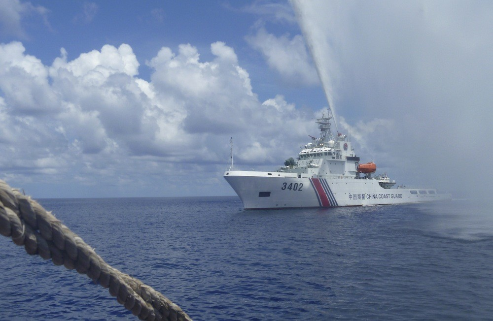 Philippines: China still guarding shoal but Filipinos back