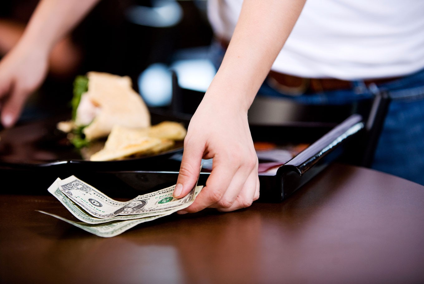 Why Americans tip waiters: A closer look at the US tipping norm