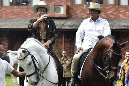 "President Joko ""Jokowi"" Widodo (left) and Gerindra Party chairman Prabowo Subianto ride horses at the latter's house in Hambalang, Bogor, West Java on Oct. 31."