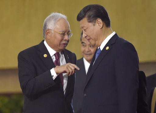 Malaysia's PM hopes to improve his image with China trip