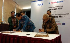 Panin Bank, BCA team up in e-money business