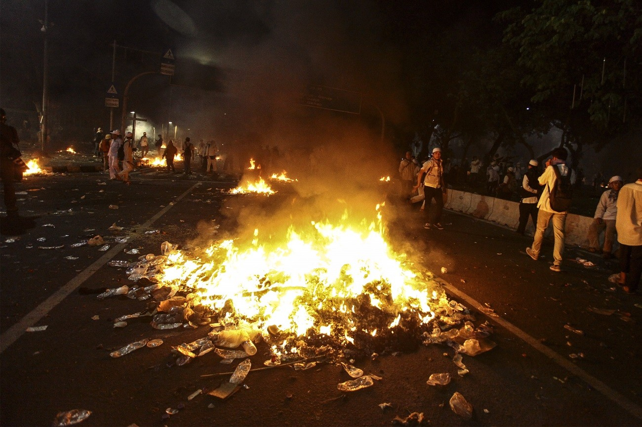Jakarta cools off after violent rally