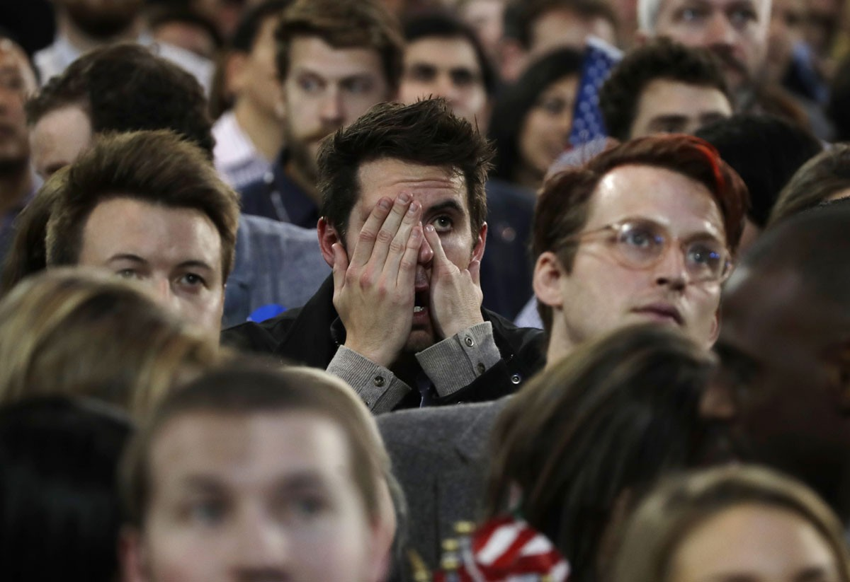 Supporters react to election results during Democratic presidential nominee Hillary Clinton's election night rally in the Jacob Javits Center glass enclosed lobby in New York, Tuesday, Nov. 8, 2016. AP Photo/Frank Franklin II
