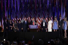 President-elect Donald Trump gives his acceptance speech during his election night rally as he is surrounded by his family and Vice-President-elect Mike Pence and his family, Wednesday, Nov. 9, 2016, in New York. AP Photo/John Locher