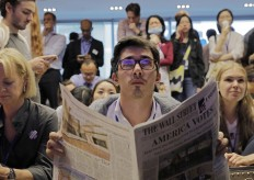 A man reacts as they watch a television broadcast of U.S. election in Hong Kong, Wednesday, Nov. 9, 2016. The United States headed for the polls to vote for their new president on Tuesday. AP Photo/Vincent Yu