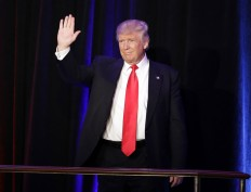 President-elect Donald Trump waves as he arrives at his election night rally, Wednesday, Nov. 9, 2016, in New York. AP Photo/John Locher