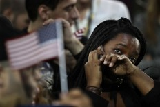 A woman weeps as election results are reported during Democratic presidential nominee Hillary Clinton's election night rally in the Jacob Javits Center glass enclosed lobby in New York, Tuesday, Nov. 8, 2016. AP Photo/Frank Franklin II