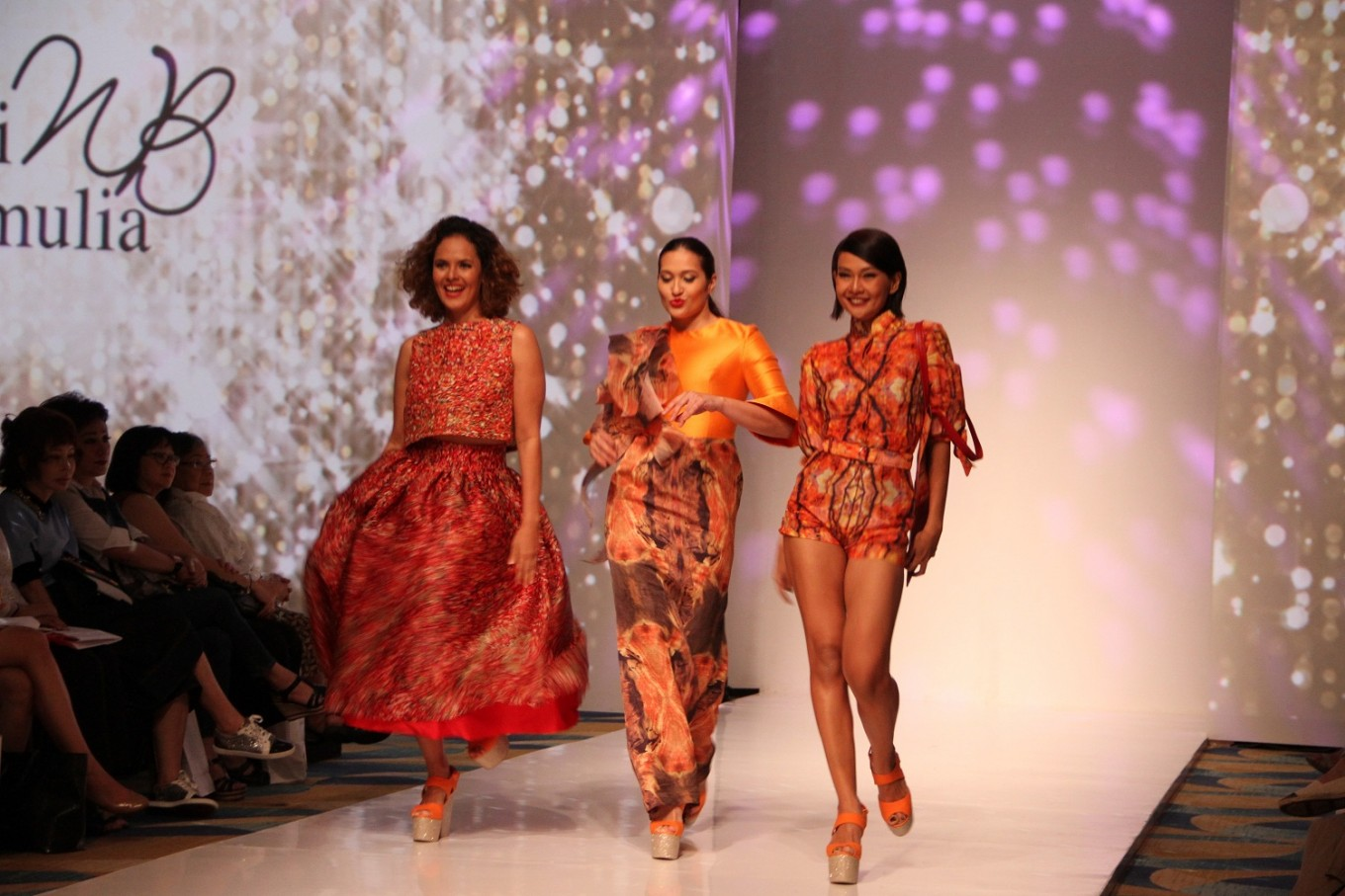 Widhi Budhimulia's 'wearable photographs' on silk struts IPMI runway