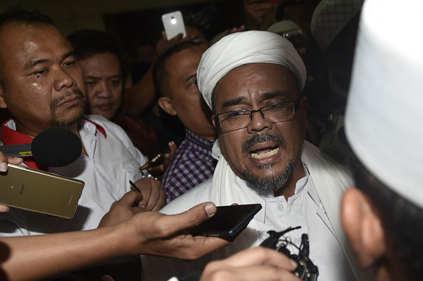 FPI leader reported to police for allegedly committing religious blasphemy