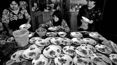 Women prepare the plates of food for the fighters following the bouts. JP/ Aman Rochman