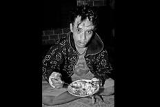 Bruised but not downfallen, Suproyadi, 19, eats his bowl of nasi soto. JP/ Aman Rochman